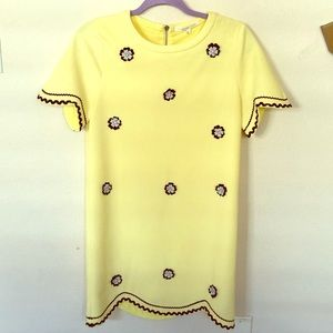 Yellow dress with  appliqué flowers